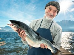 Fisherman holding a big Atlantic SalmonPhoto by: (c) gajdamak www.fotosearch.com