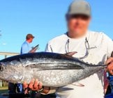 Fisherman Holds Up His Albacore Tuna Catch Photo By: Tiffany Woods, Oregon Sea Grant Https://creativecommons.org/licenses/by/2.0/
