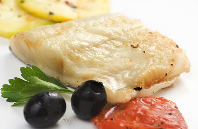 Fillet of Black Sole ready for the pan Photo by: (c) AntonioMP www.fotosearch.com